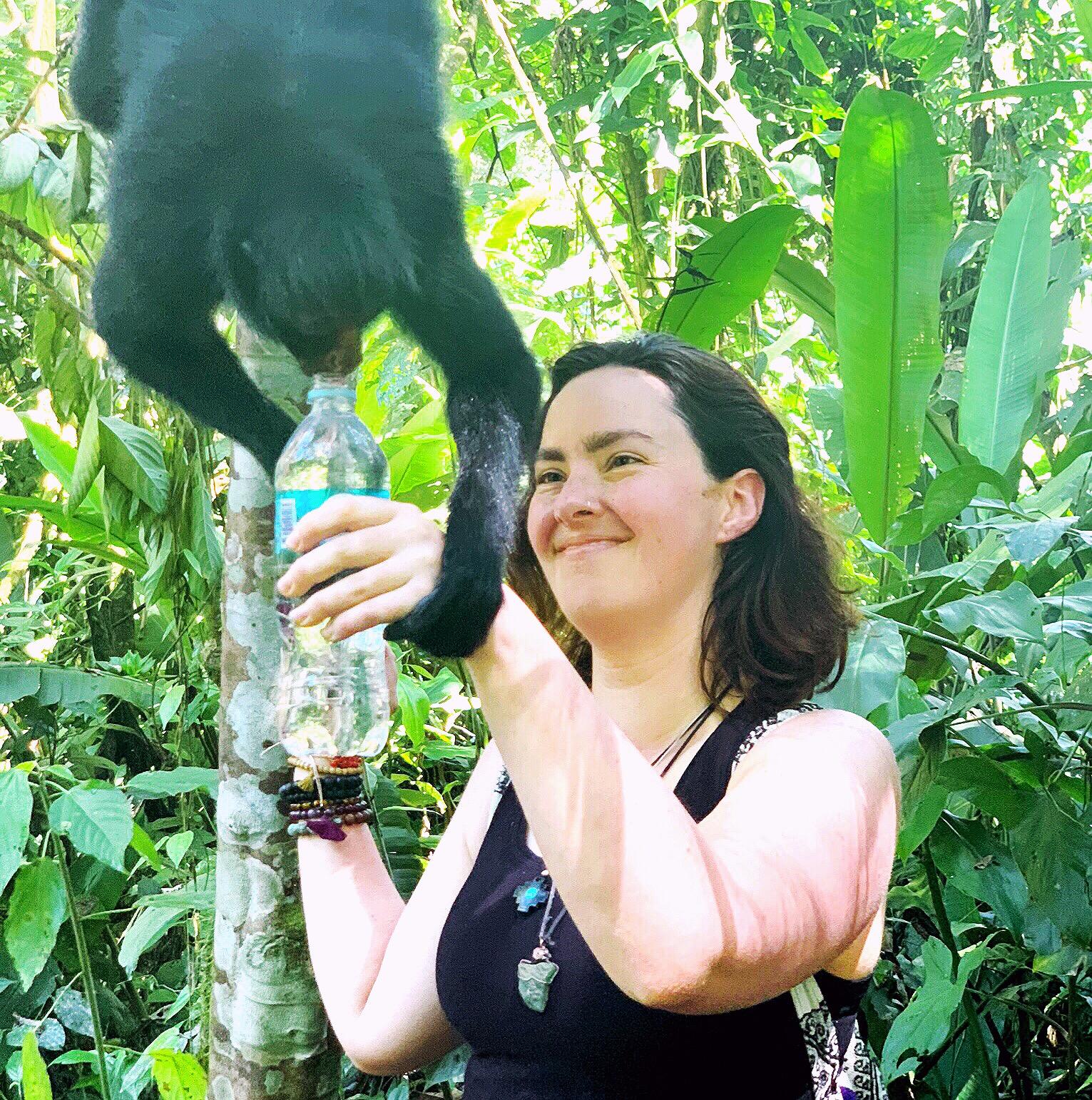 Mackenzie and a spider monkey in Peru.