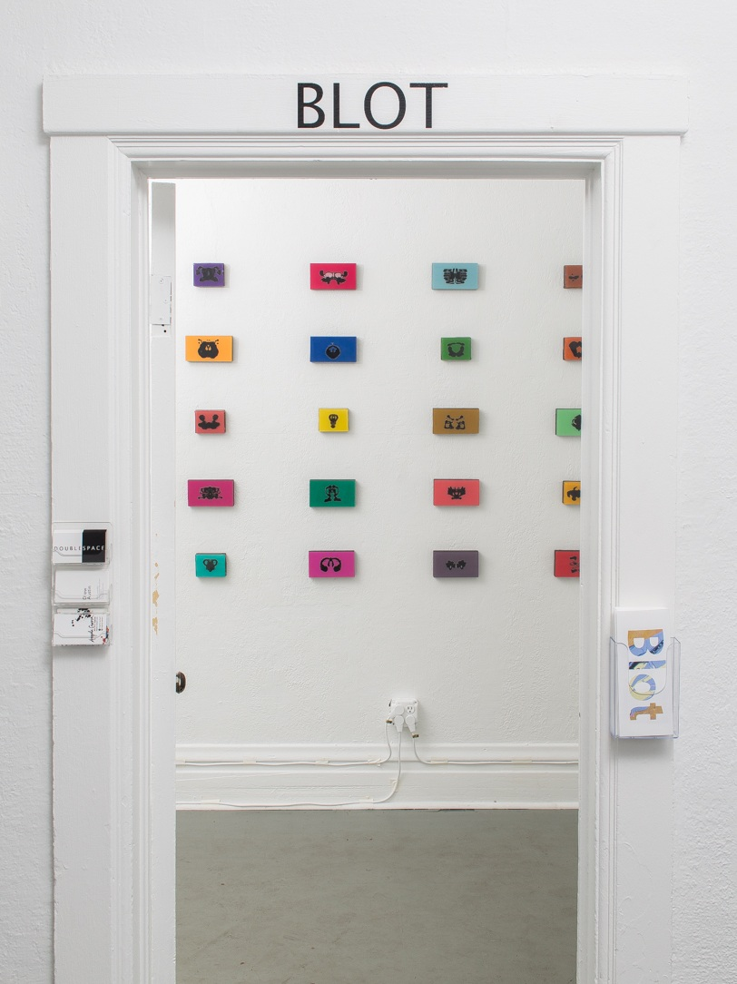 """View of  Blot at  DoubleSpace   showing  Interpretive Expressionism 1-30 , Angela Craven, resin/mixed media on wood, 4""""h x 7""""w $200 each, 3""""h x 7""""w, $150 each, photograph by  Matthew Pevear"""