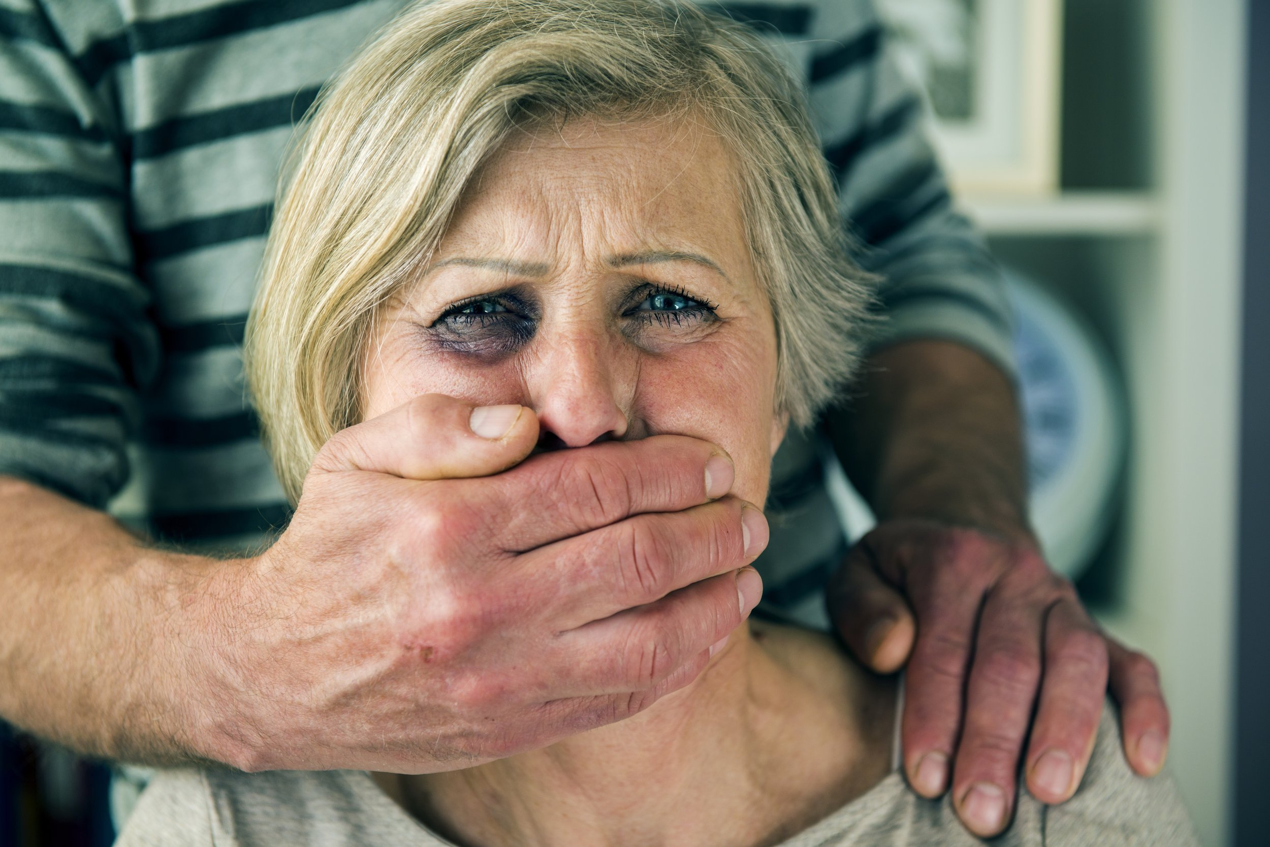 graphicstock-portrait-of-woman-victim-of-domestic-violence-man-abusing-senior-woman-with-black-eye_HRlxkbG3-Z.jpg