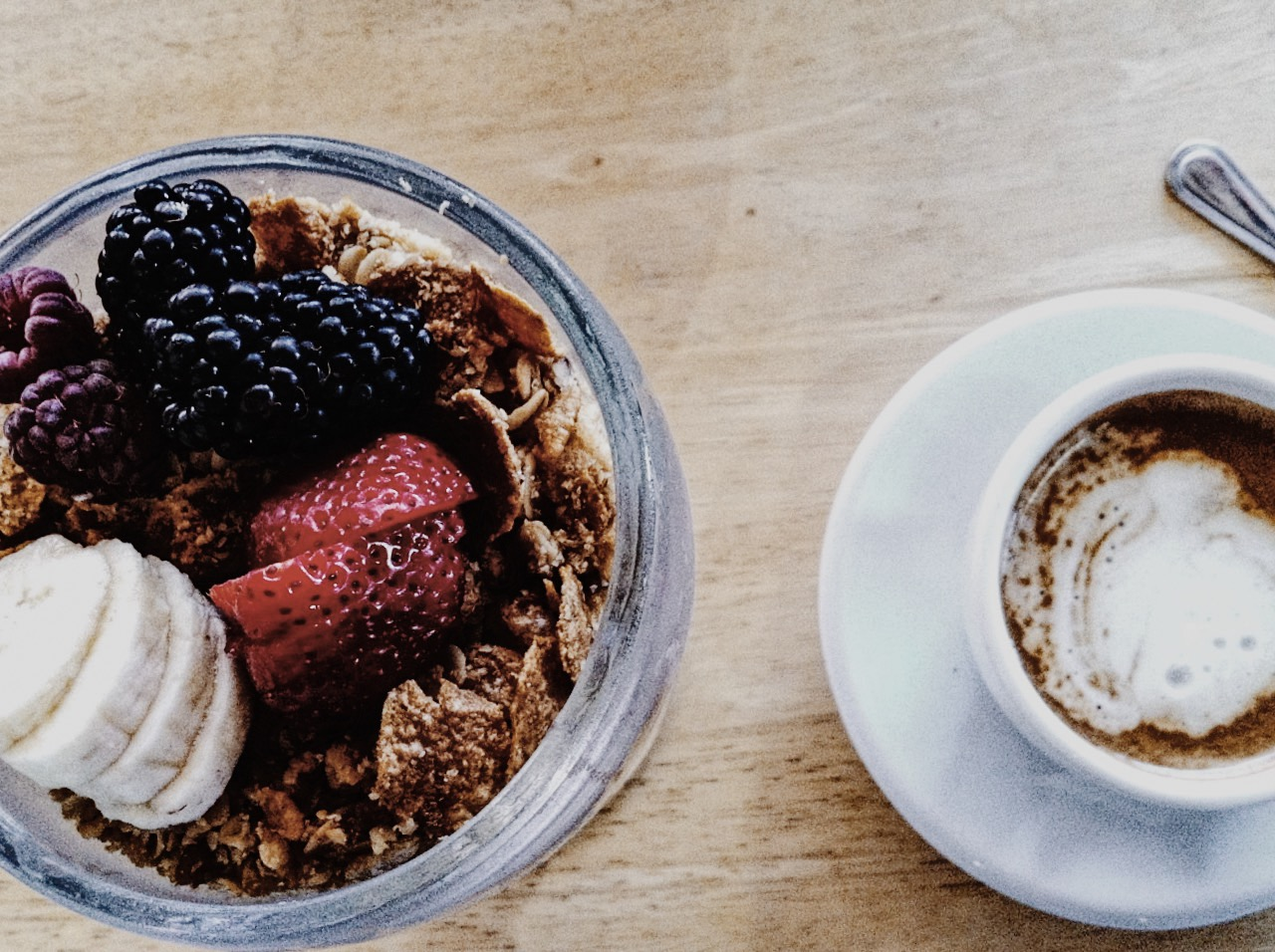 Sally Loo's Wholesome Cafe offers a variety of brunch items and coffee beverages. Pictured above is an acai bowl and cappuccino.