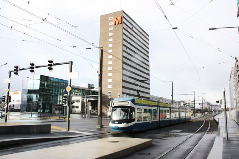 Tram Station, Toni Areal, Tram 4, Studio Building in the Background, access through glass cube.