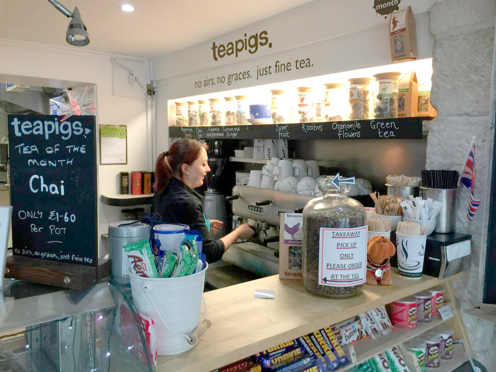 front-counter-photo-with-lady-smiling-white-stones-cafe-art-gallery-portland-dorset.jpg