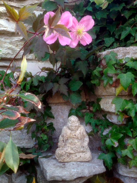 photo-of-buddha-sculpture-in-garden-portland-dorset.jpg
