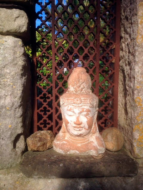 photo-of-terracotta-buddha-sculpture-in-garden-portland-dorset.jpg