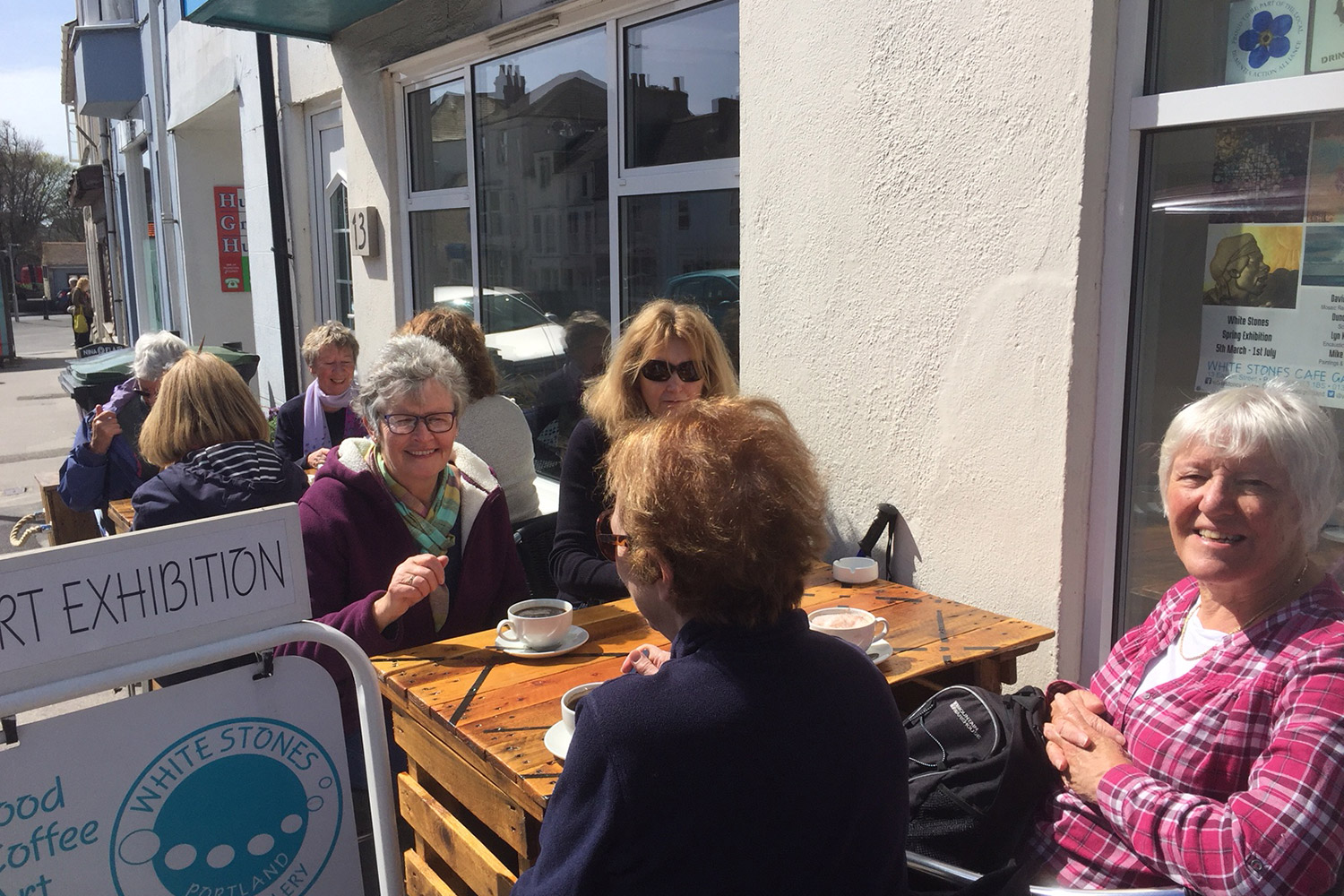 diners-chatting-and-eating-outside-white-stones-art-cafe-gallery-portland-dorset.jpg