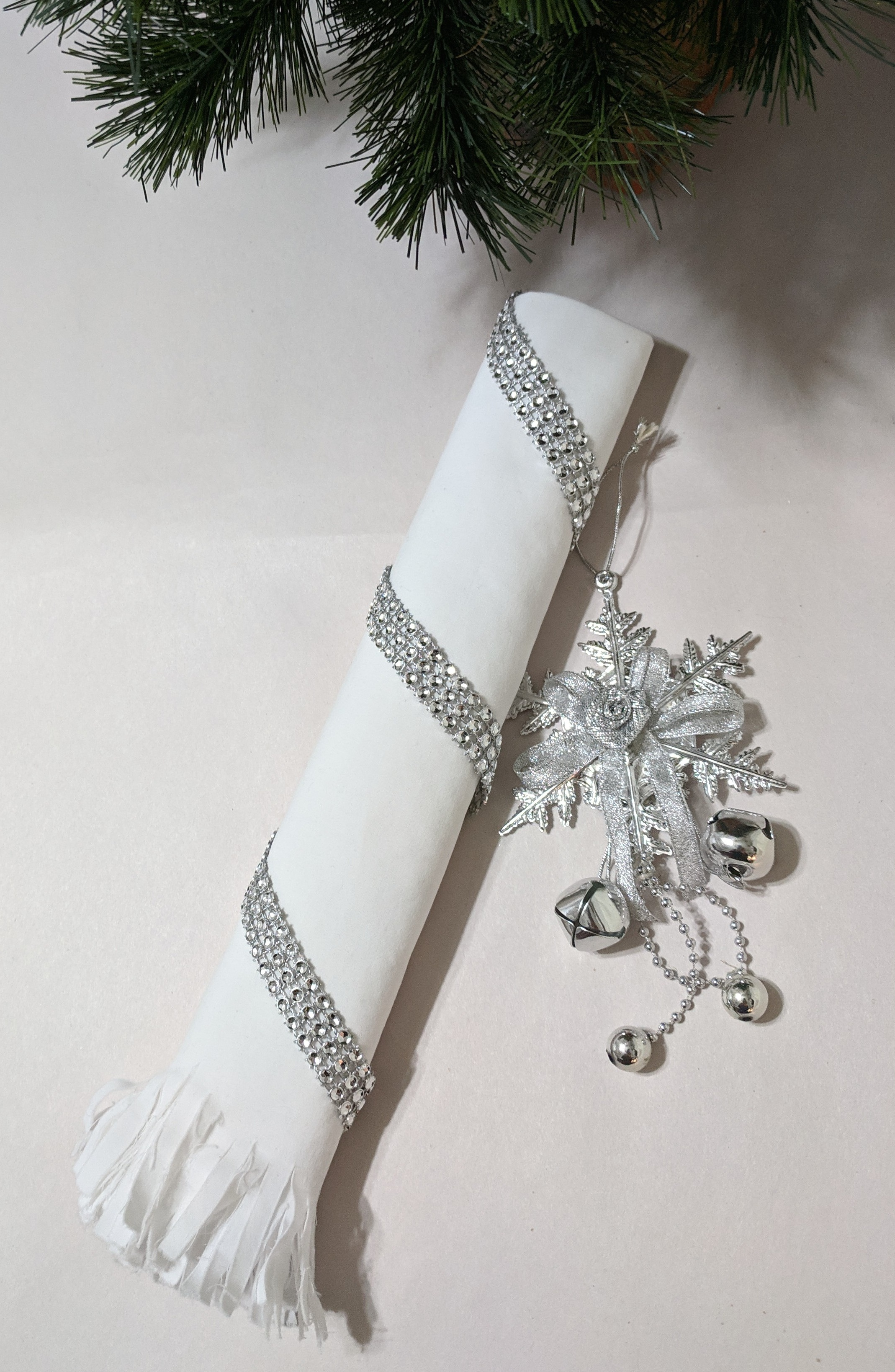Make It a Wrap - White poly/cotton sheeting fringed and wrapped in a diagonal strip of sequins