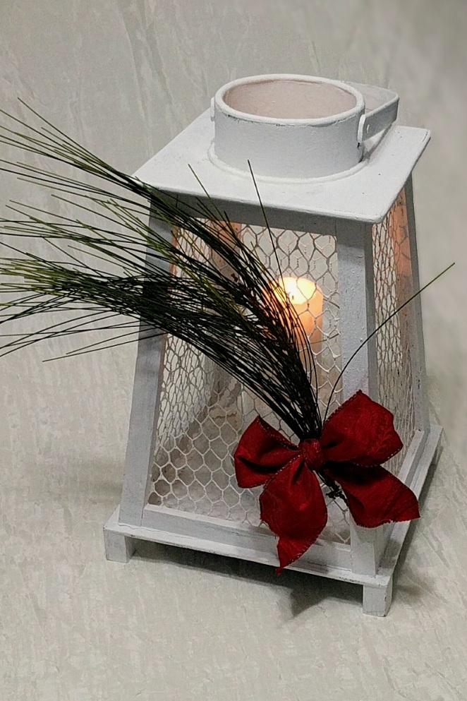 Merry, Bright and Party Safe - This chicken wire lantern glows with the season's warmth. Hurricane globes and lanterns require less precaution in party settings