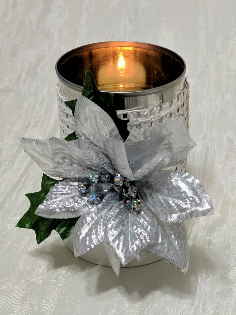 A Pretty Dolled-Up Tin Can - A condensed milk can is dressed up in white paper ribbon and silver faux poinsettias