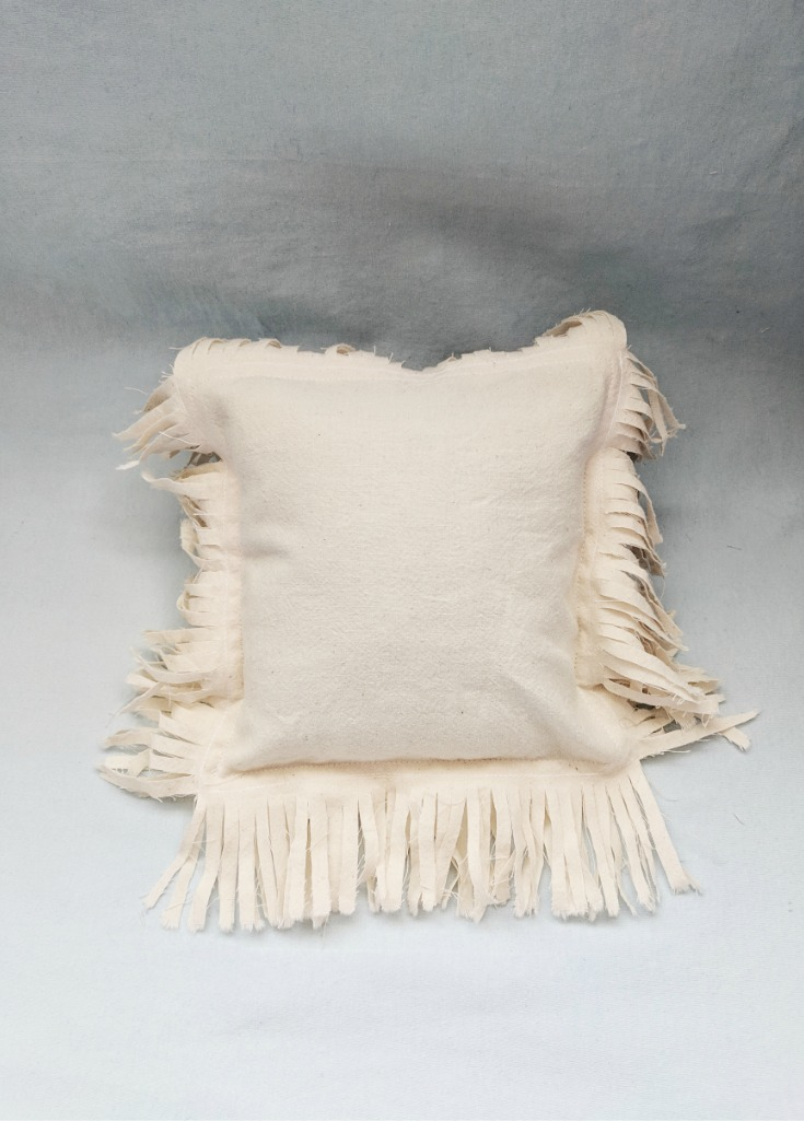 Above:  Muslin cushion cover with self-fringe  before  washing. Notice the difference in the fringe in image below.