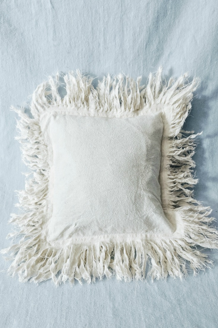 Above:  Cushion cover completed and washed a second time; repeat washings causes the fringe to bloom.