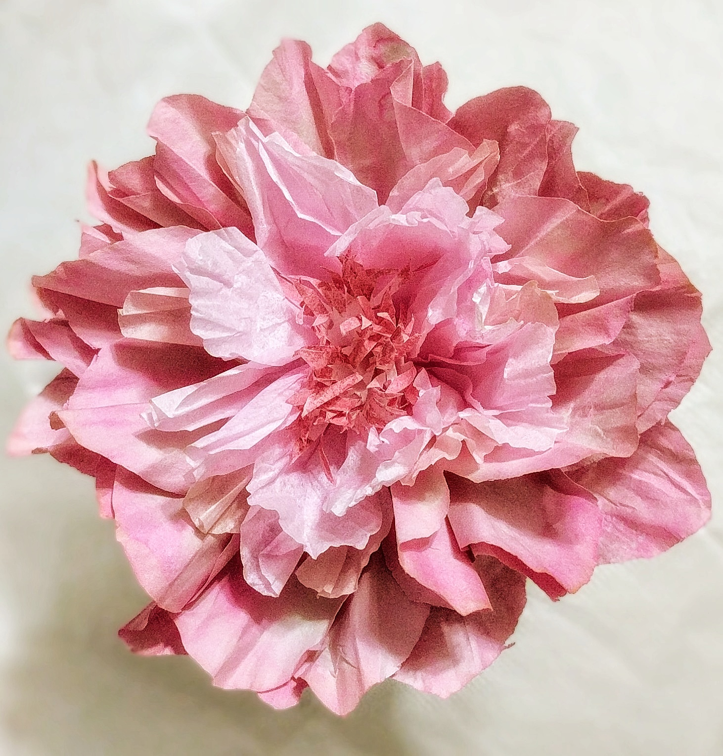 Dip-Dyed Colour - Left: Diluted craft paint gives this newsprint flower its rich hues.
