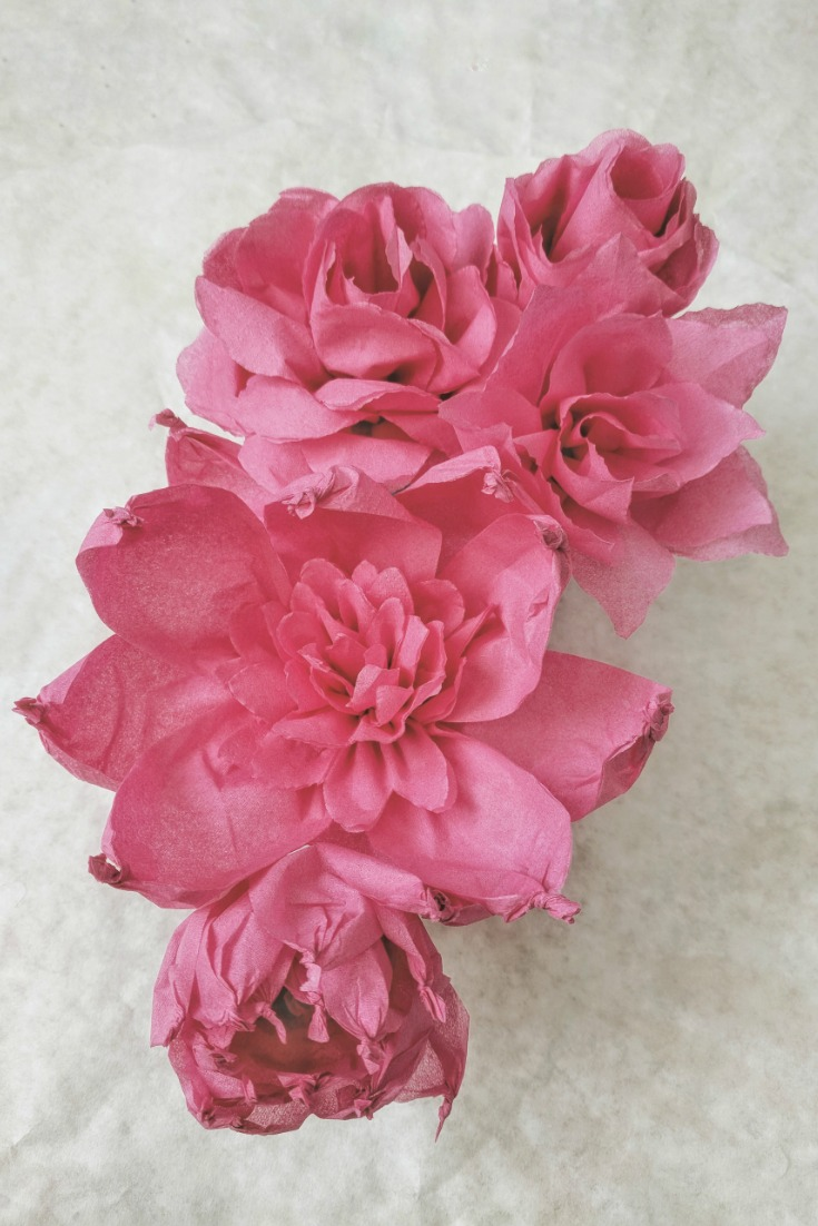 Above:  The deep pink paper napkins is an easy craft. Twisting some petals at the tips lends create variation and contrast to the single colour arrangement.