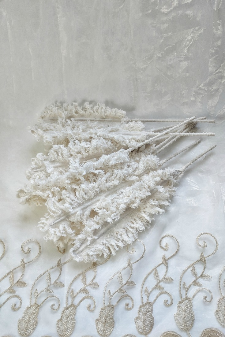 Above:  It takes approximately  10 minutes . plus washing and drying time to create  un-dyed   fluffy  fabric feathers.
