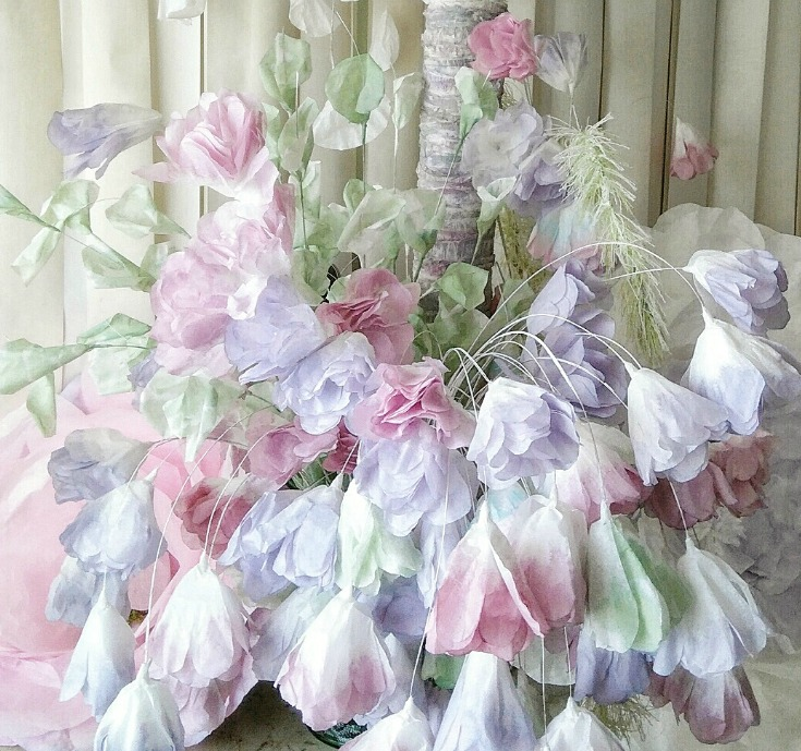 Above:  These pastel coffee filter flowers sit at the bottom of a tall two tiered centrepiece in a blaze of glory.