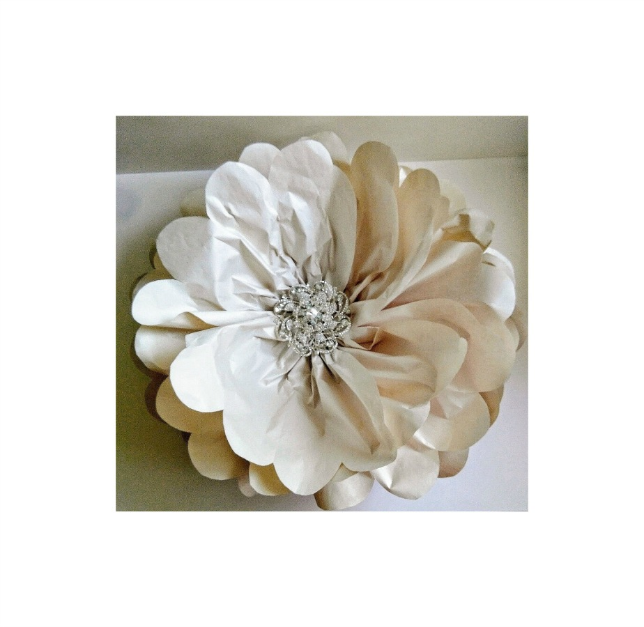 """Jewelled Centre Newsprint Flower - Left: The simple 26"""" wide flower got its dazzling centre from a 4"""" brooch."""