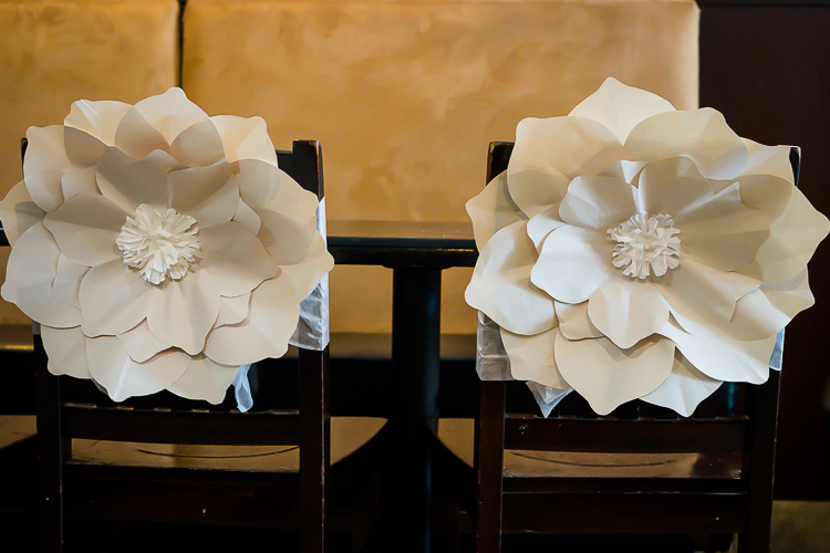 Above:  Newsprint circles; folded, cut and shaped in different sizes and stacked creates another variety of flowers.