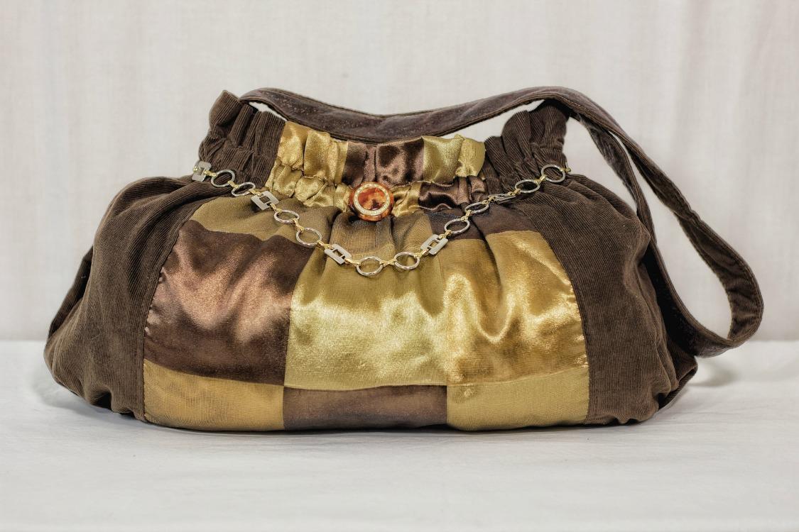 brown-gold-handbag-shoulder-gold-chain-trim.jpg