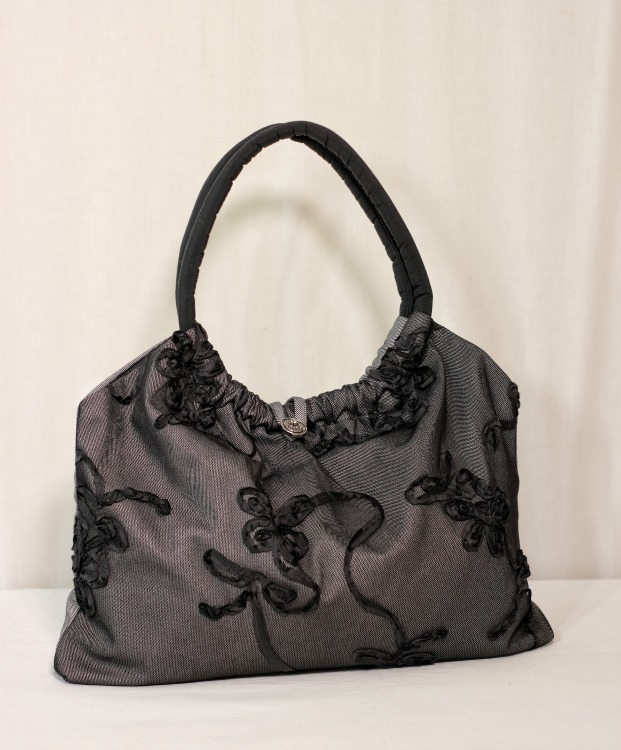 Above:  Sew up a pretty easy handbag or tote in less than an hour. Made with denim overlaid with net. Handles padded with wadding.