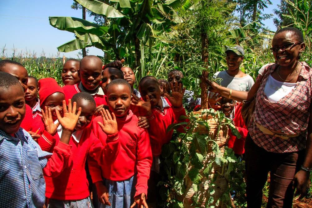 GEEP KENYA Founder faith with the kids at the school nutrition garden..jpg
