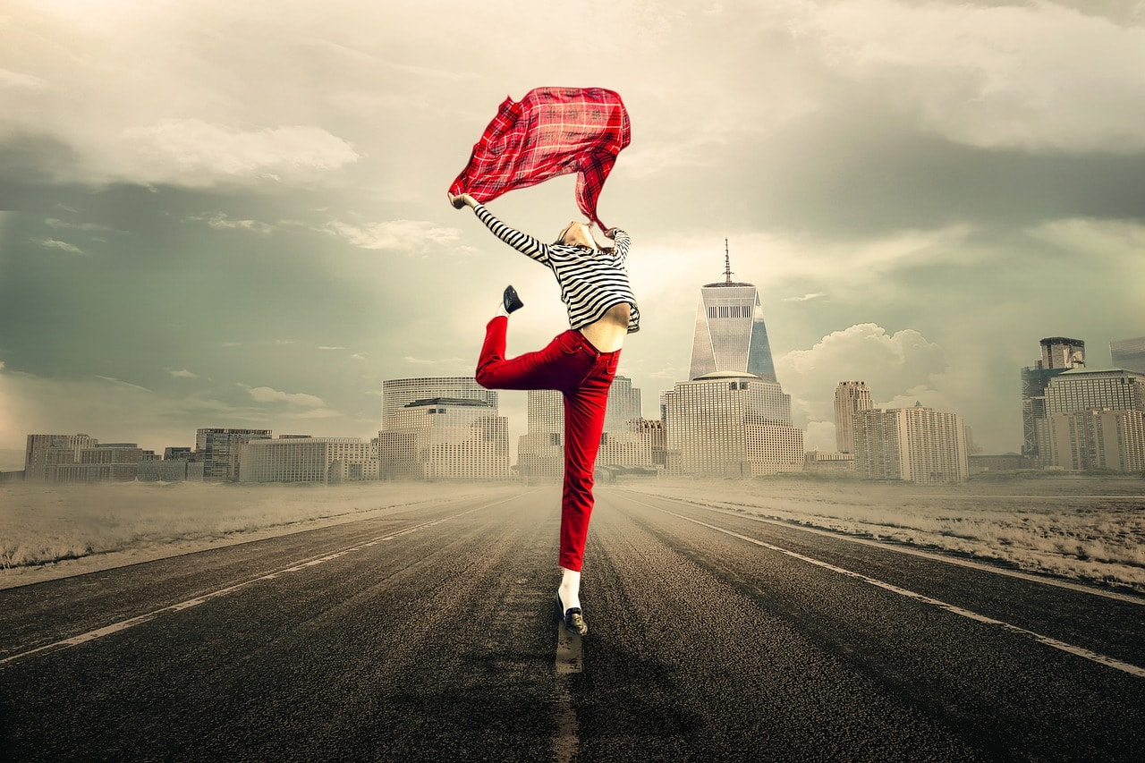 Woman in red trousers jumping for joy - Life Coaching