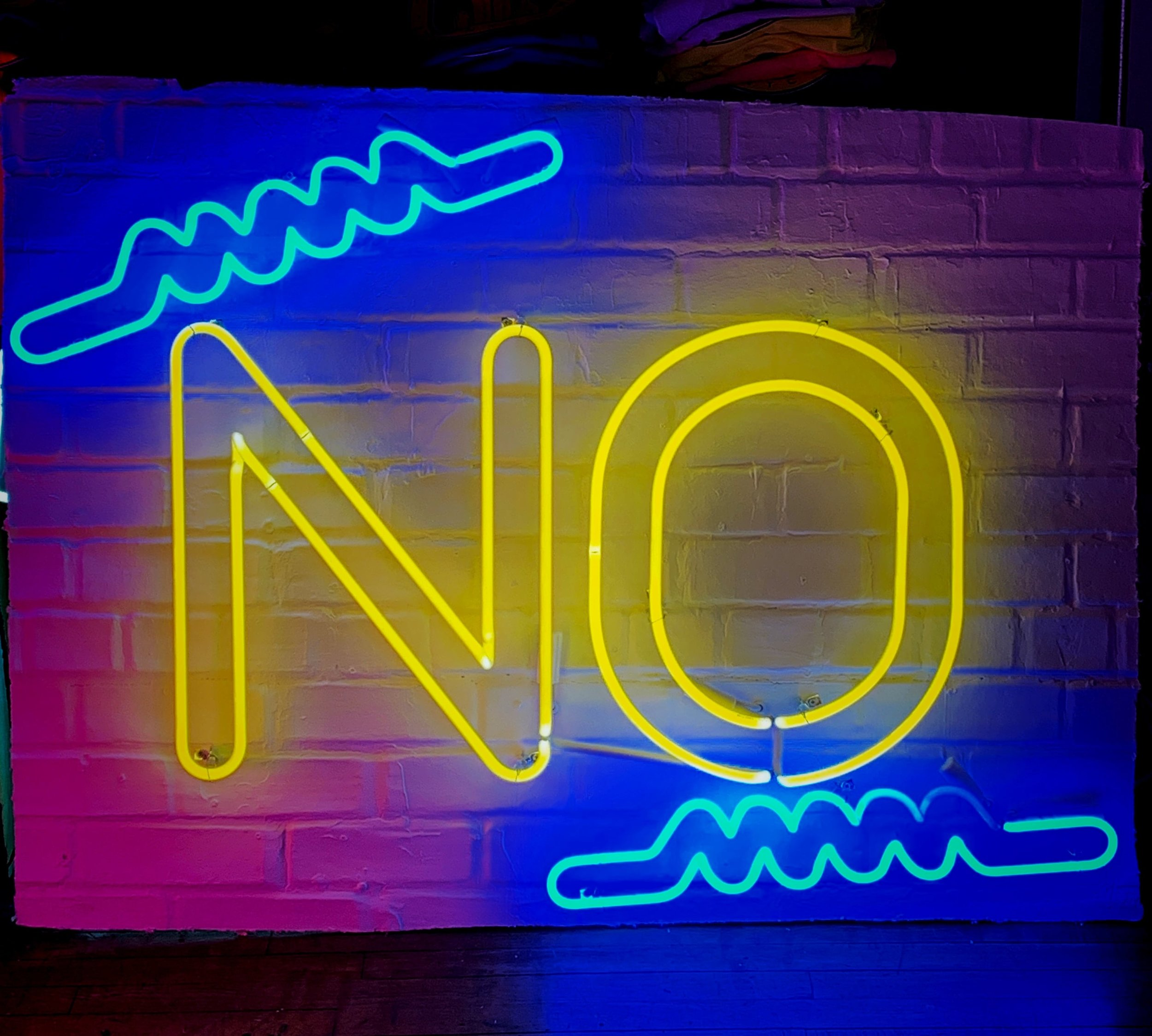 a neon sign saying NO - how to say NO to people - Life coaching for conscious living