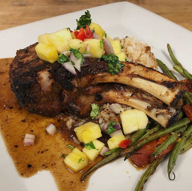 Tonight's dinner special includes an Mesquite Smoked Pork Chop served with rice, veggies & topped with Jamaican Jerk sauce and Pineapple Salsa  #dinner #special #friday #bozeman #redchairmt
