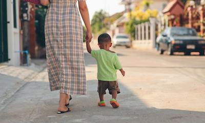 Child lives in foster care in community of origin -