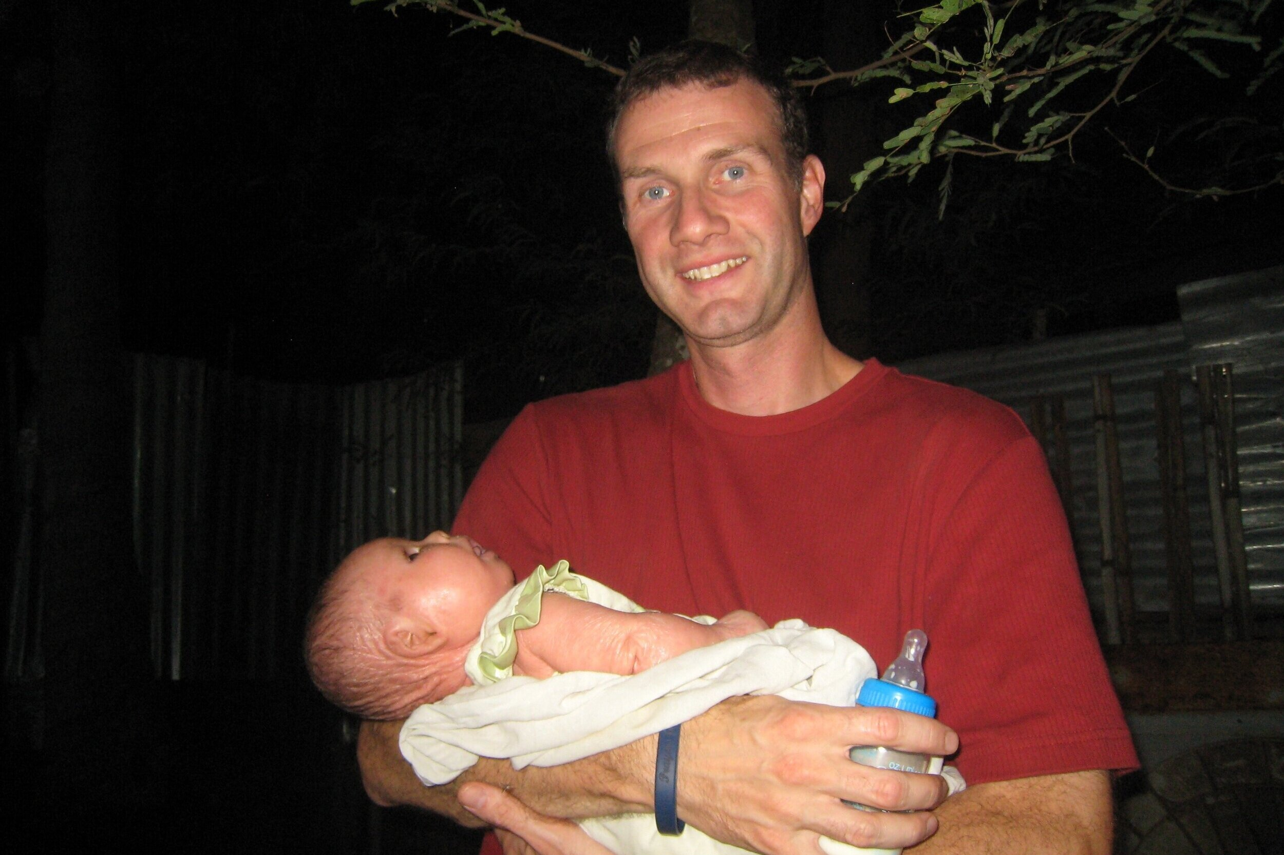 Our longtime volunteer, Adam Rogers, holding Su Su, months after she survived her time at the hospital. He is our #1 Aquaphor carrier! He's been committed to this little girl since birth and has literally provided years of the life-saving cream for Su Su.
