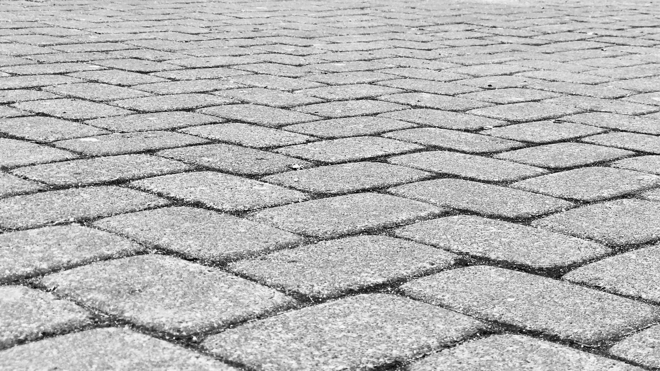 Sidewalk and street pavers are cooler and more porous