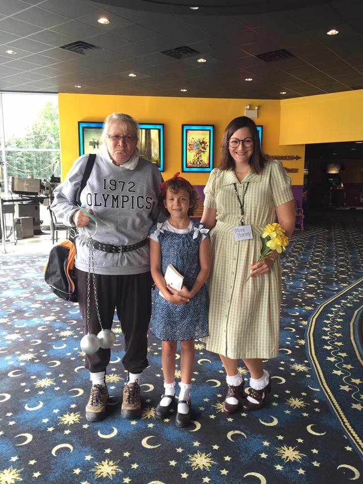 Erin is a serious Roald Dahl fan! Here she is dressed as Miss Honey from  Matilda  (and her mom is dressed as Miss Trunchbull) at a private screening of  The BFG  movie she planned for her students. Everyone dressed up as characters from Dahl books!