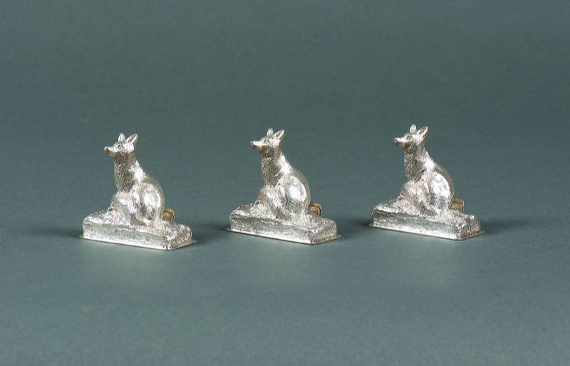 HR T ROBERT Set of 3 silver fox menu holders, Garrards.JPG