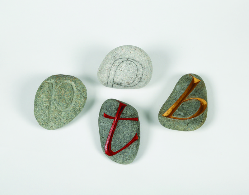 HR WAYNE HART Collection of carved pebbles by QEST scholar Wayne Hart.JPG
