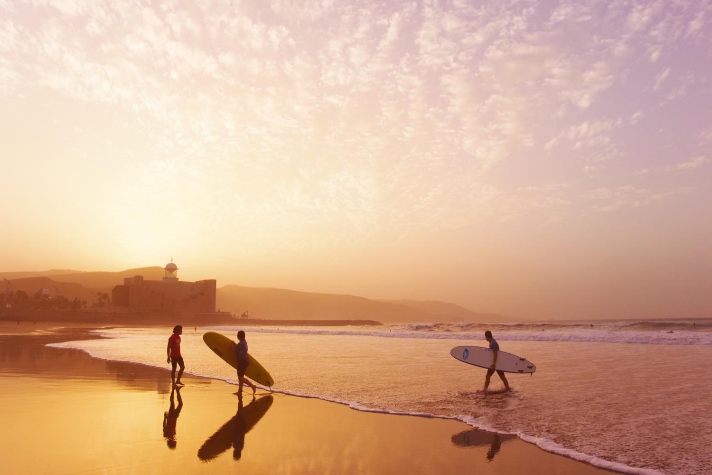 Surfer dudes on Las Canteras the cheshire magazine luxury lifestyle