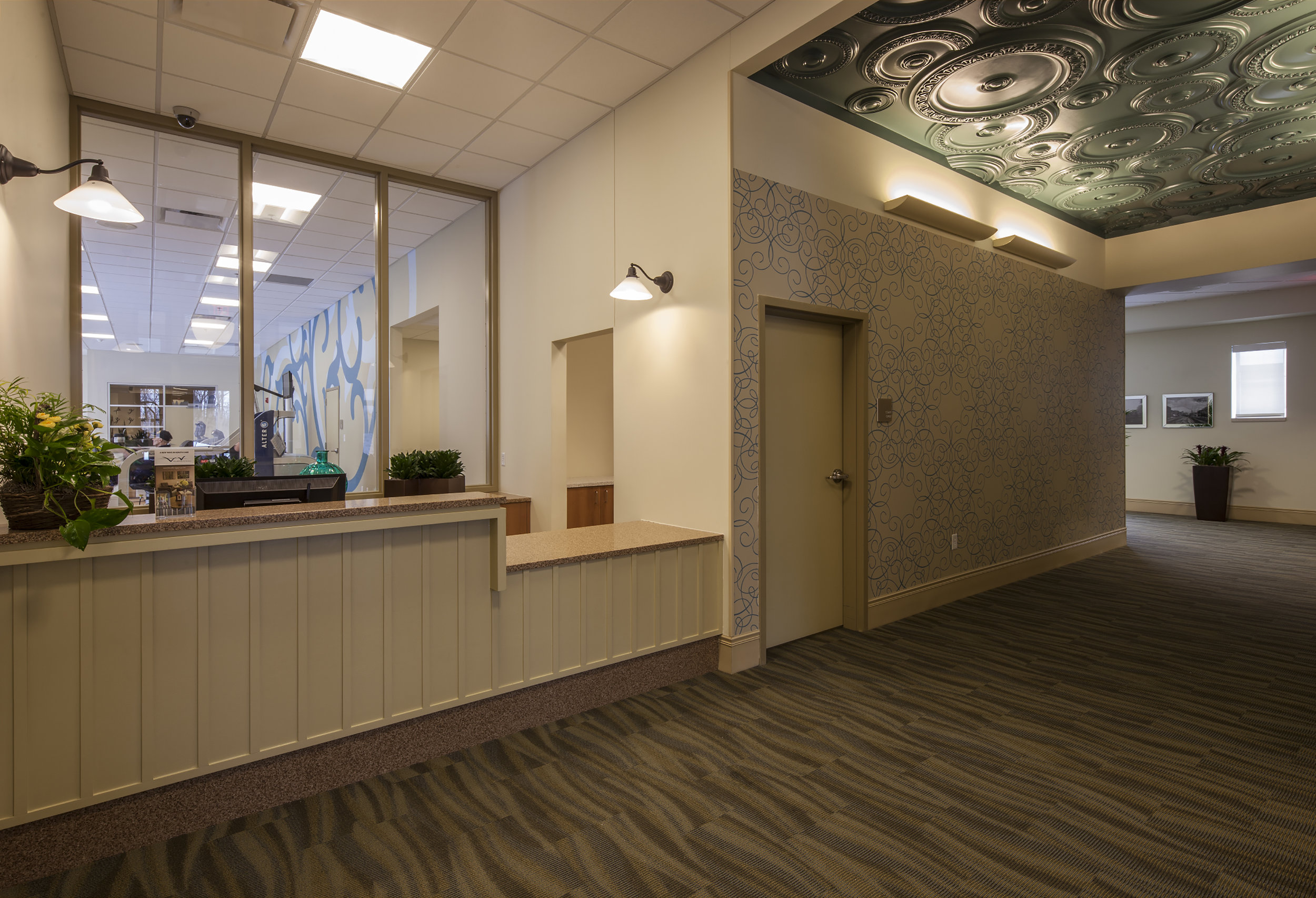 Reception desk with therapy suite beyond.