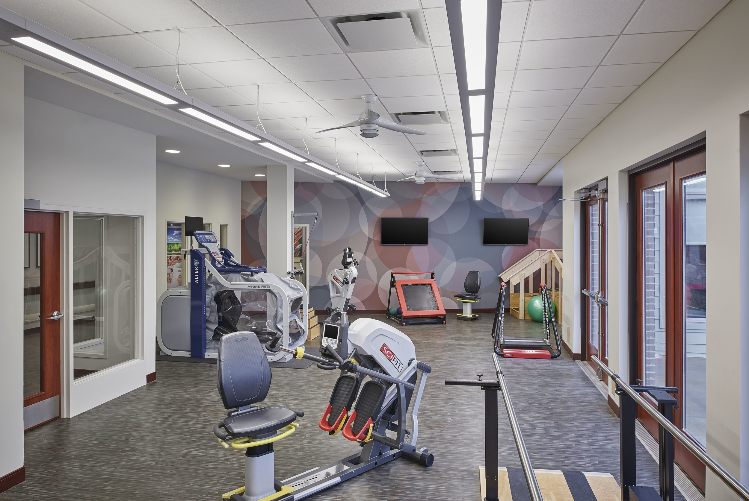 A Therapy Gym with plenty of natural light and state of the art equipment.