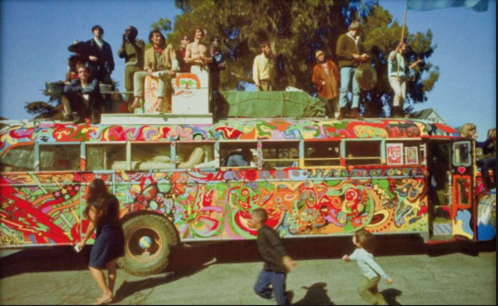 The original jesters, the Merry Pranksters cruisin' down the highway in their acid-mobile.