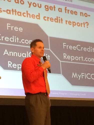 Todd teaching people how to access their free credit report at a recent teachers conference.