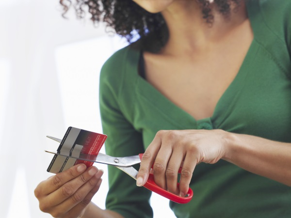 Cutting up your cards or otherwise making them inaccessible can help prevent using them and extending the length of time required to pay them off.
