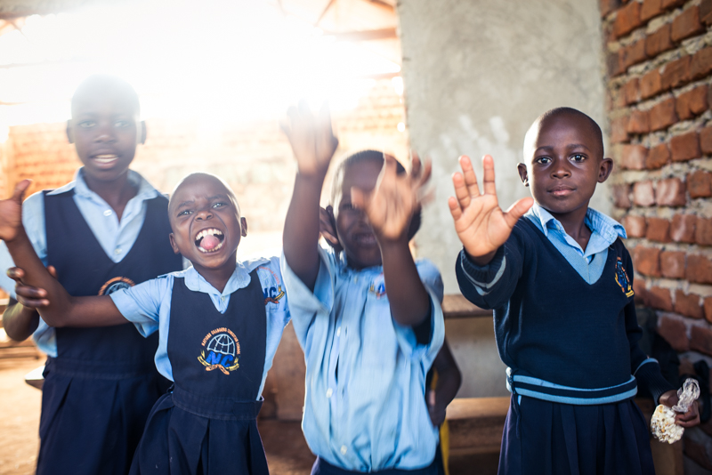 Students play during a break from school. Children attending Nation's Changers school, Wakiso Village, receive a morning snack and afternoon lunch every day thanks to our Child Sponsorship program.