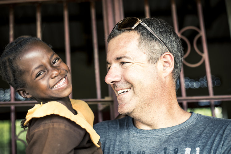 Steve with Guru Guru village child, Stella, 2014.