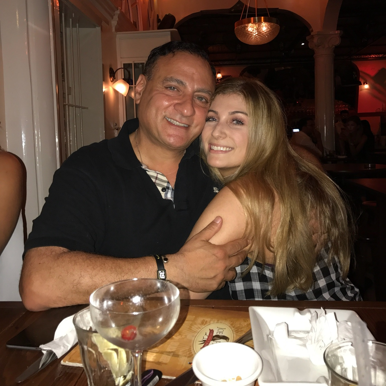 """Chloe   Orange County, CA    What is your dad's name?  Gihad   What's your favorite memory of your dad?  His ability to make a room feel whole. Not one memory can suffice. His endless jokes, advice, smile and joy. The way he called my sisters and I """"my girls"""".   What do you miss (or not miss) about your dad?  I miss his presence. I miss his eggs and popcorn, his loud phone calls in the morning talking to everyone, his days in the garden, sitting having coffee, sitting at night in the bedroom gossiping with my whole family before bed."""