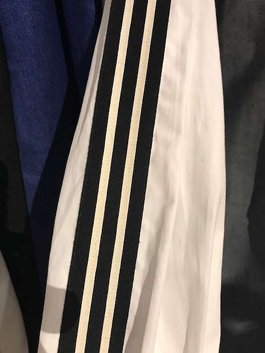 Regimental stripes seen on trousers and sleeves could easily be translated onto a sofa or dining chair, or added to a bed dressing.