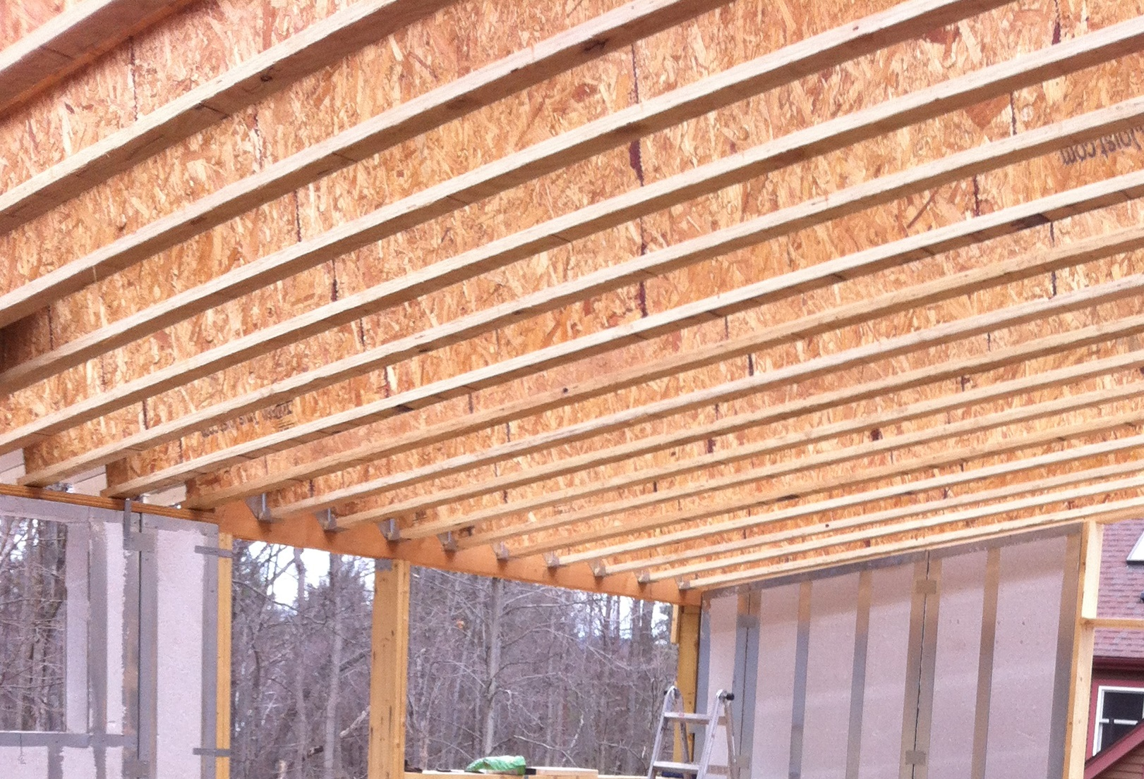 Manufactured I-joist rafters: dimensionally stable and strong, uses waste wood material, extensive processing with glues, extensive transportation energy used