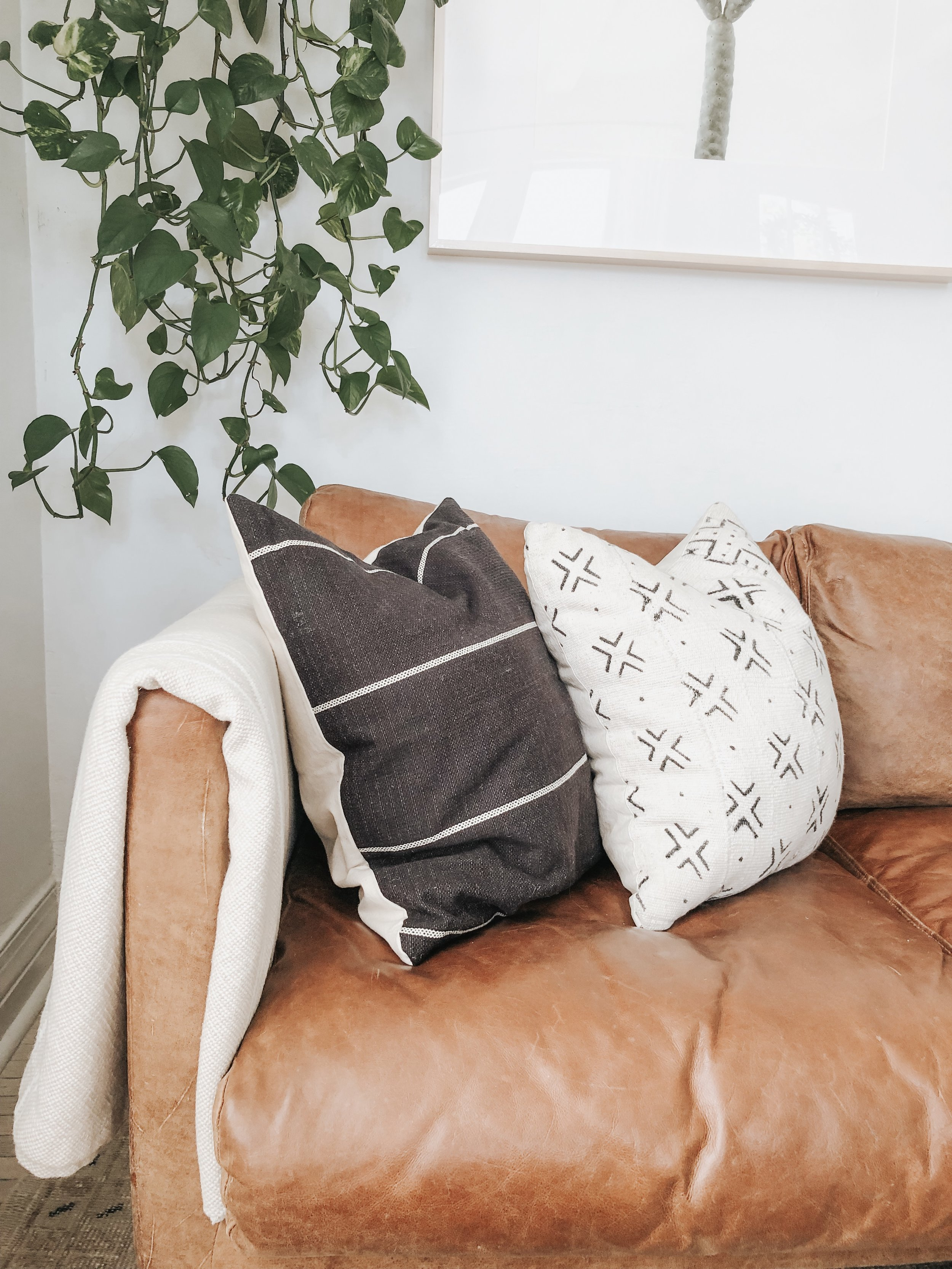 Sources:  Black striped pillow  |  Throw blanket