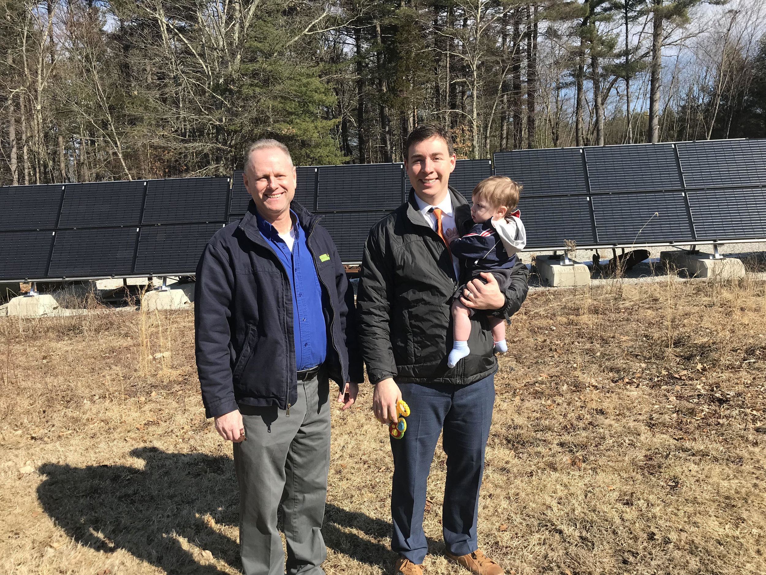 Mike Kelly and Senator Ryan Fattman with son Grant at Mass Renewable's residential ground-mount install in Mendon.
