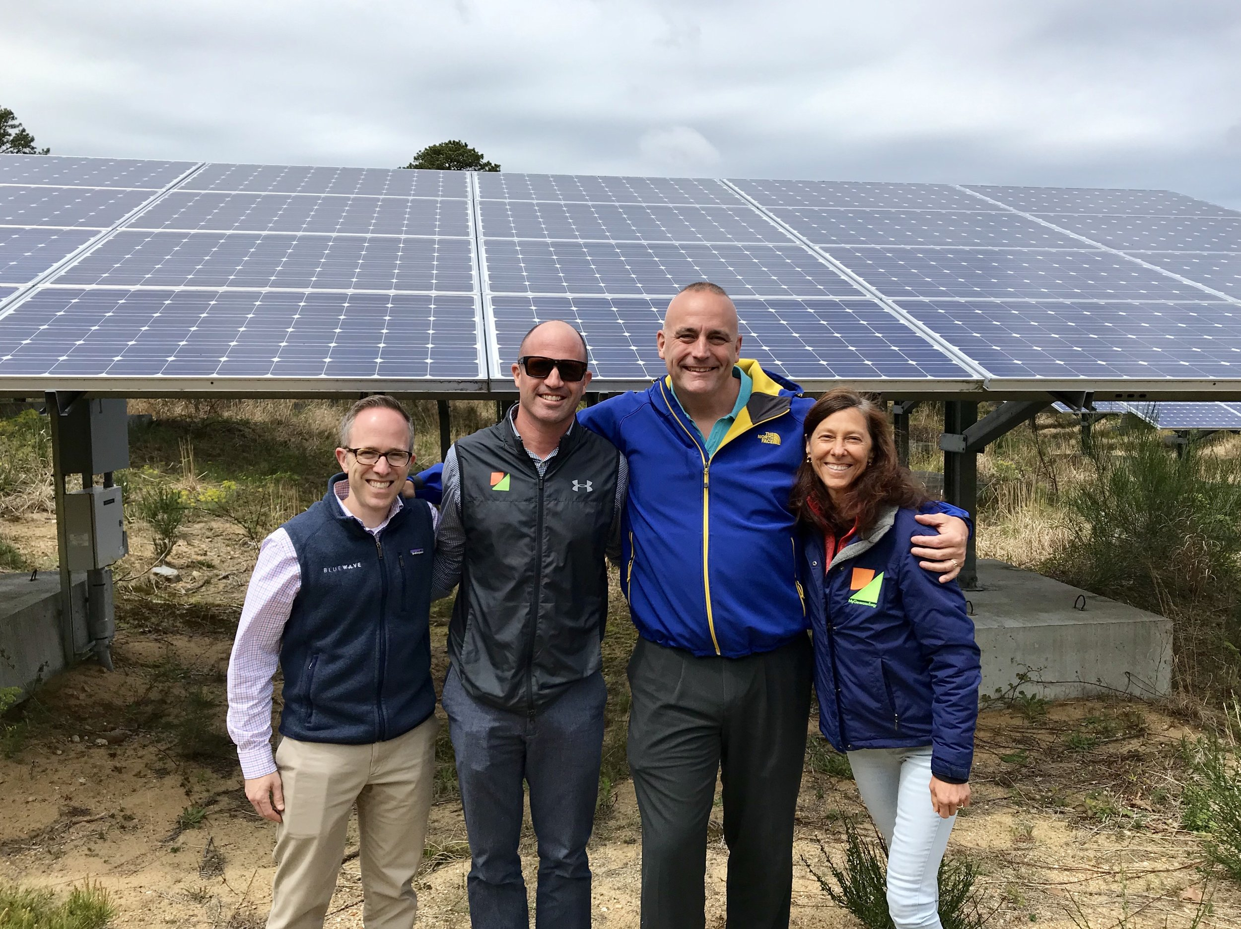 Mark Sylvia, Representative Whelan, and members from My Generation Energy at the Brewster Community Solar Garden.