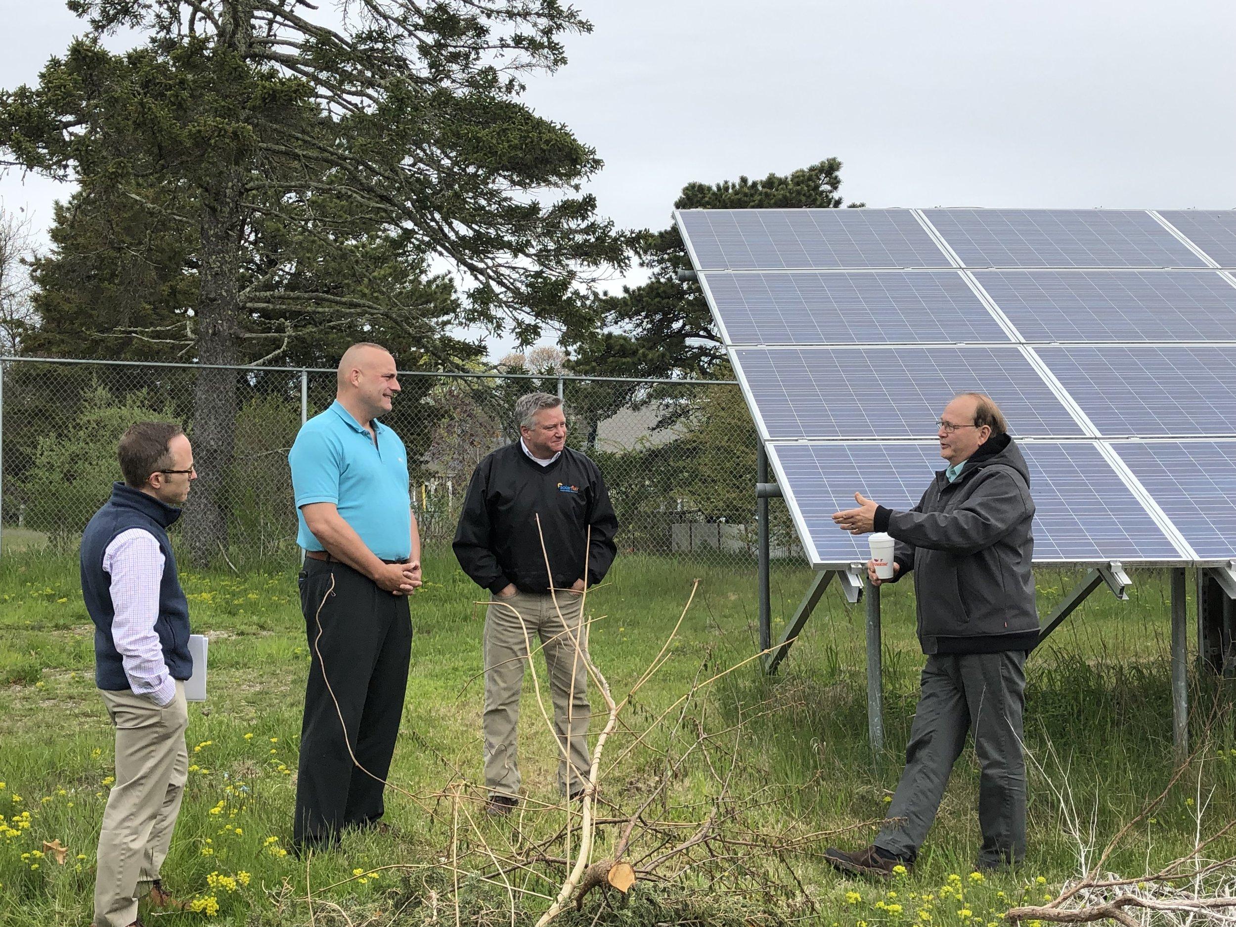 Mark Sylvia, Representative Whelan, and members from Solar Flair at Ray Hebert's installation.