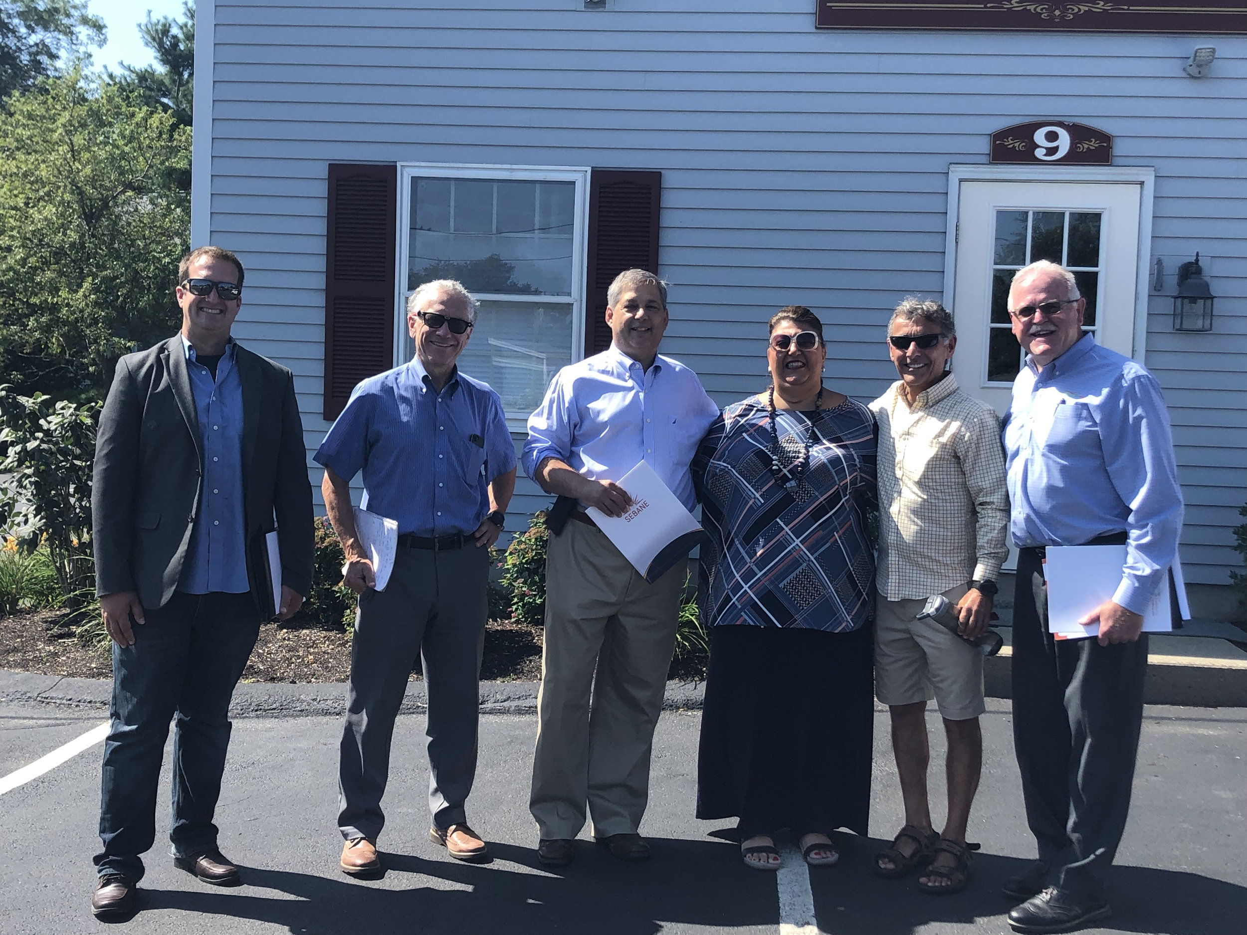 Pictured left to right: James Mazer, ReVision Energy; Eric Krathwohl, SEBANE; Senator Bruce Tarr; Mayor of Gloucester Sefatia Romeo Theken; Peter Vadala, property owner; Tim Sanborn, Cazeault Solar & Home