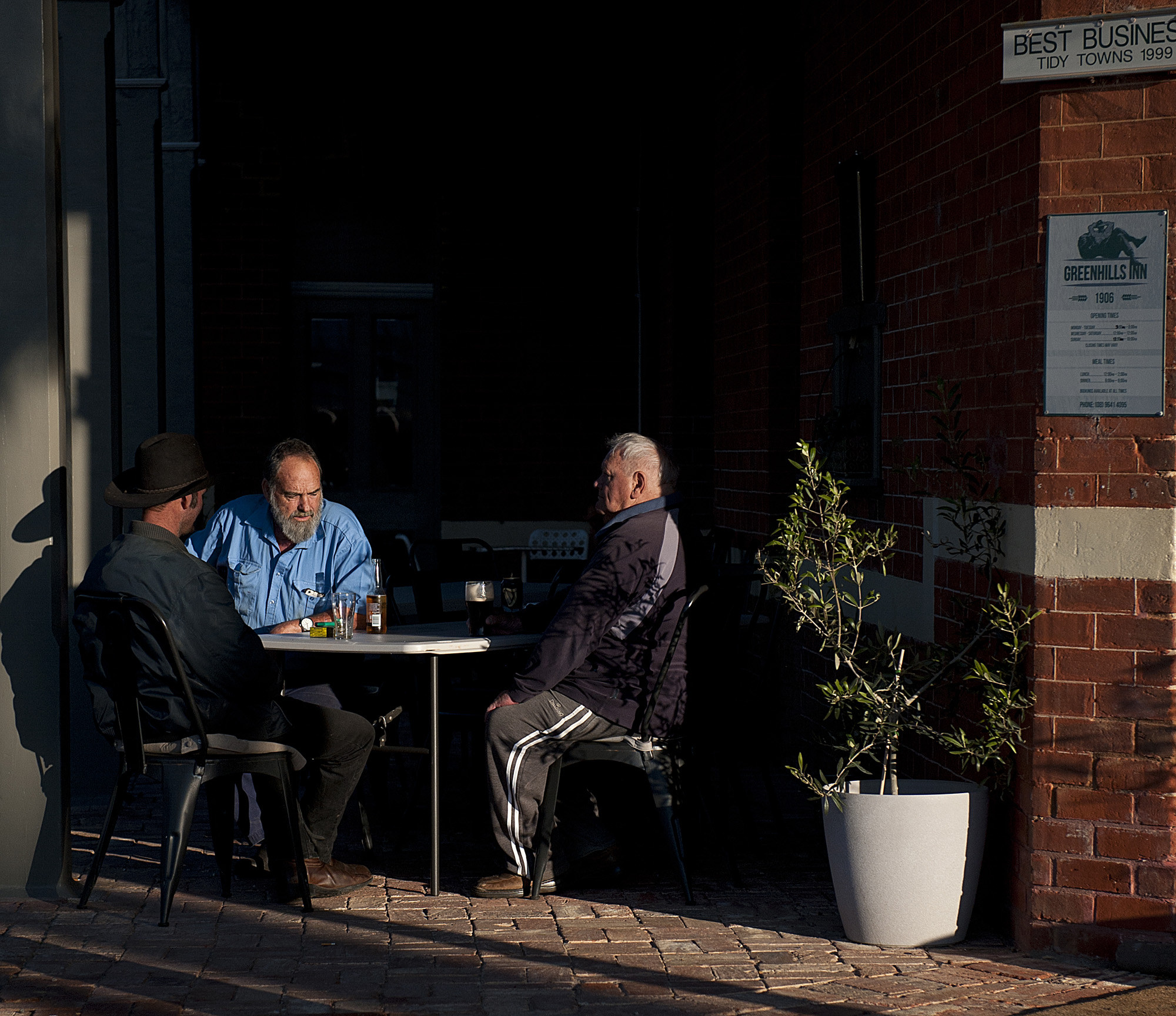 locals having a beer near the front door outside.jpg