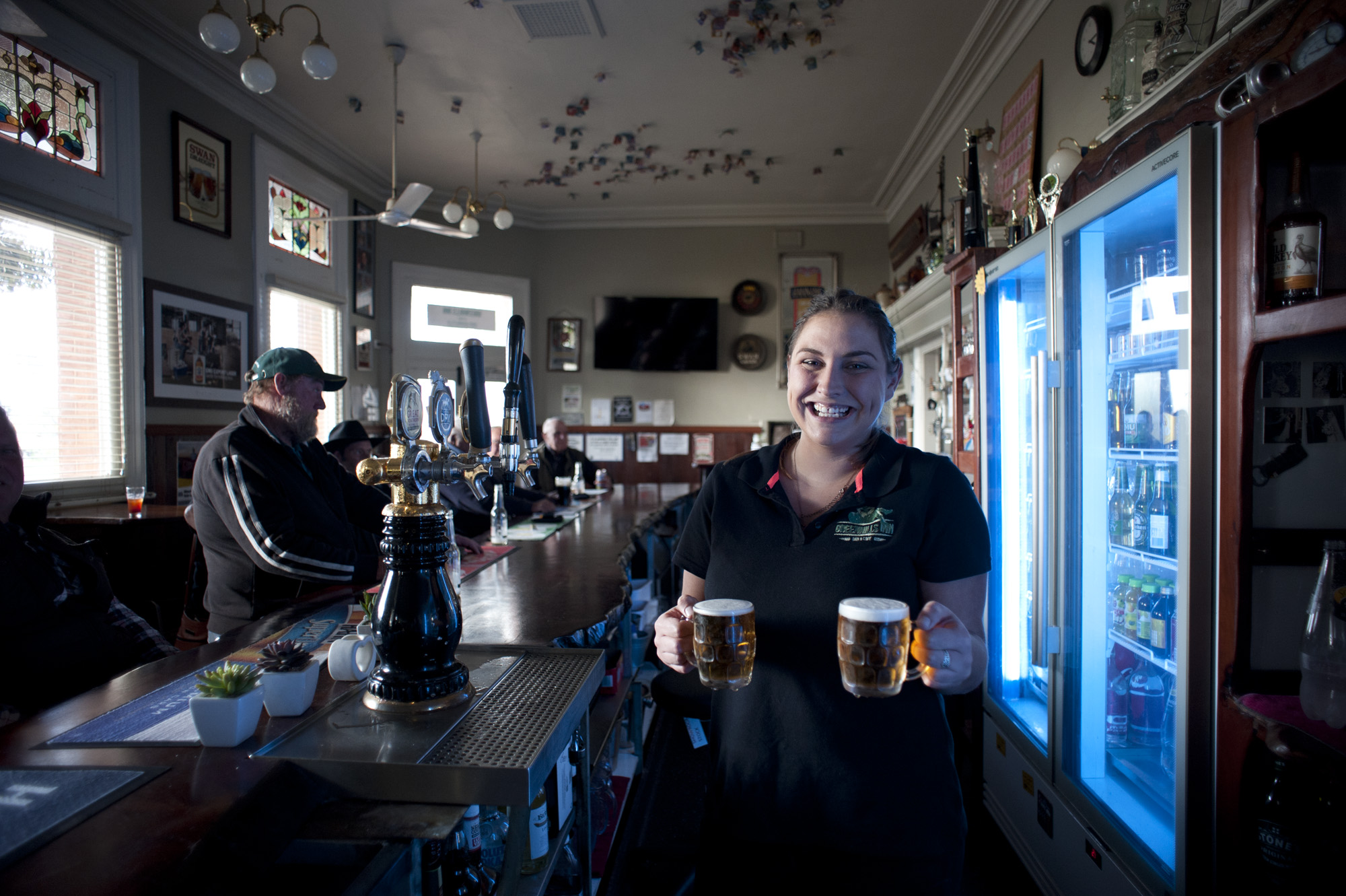 Bar maid with beers in bar.jpg